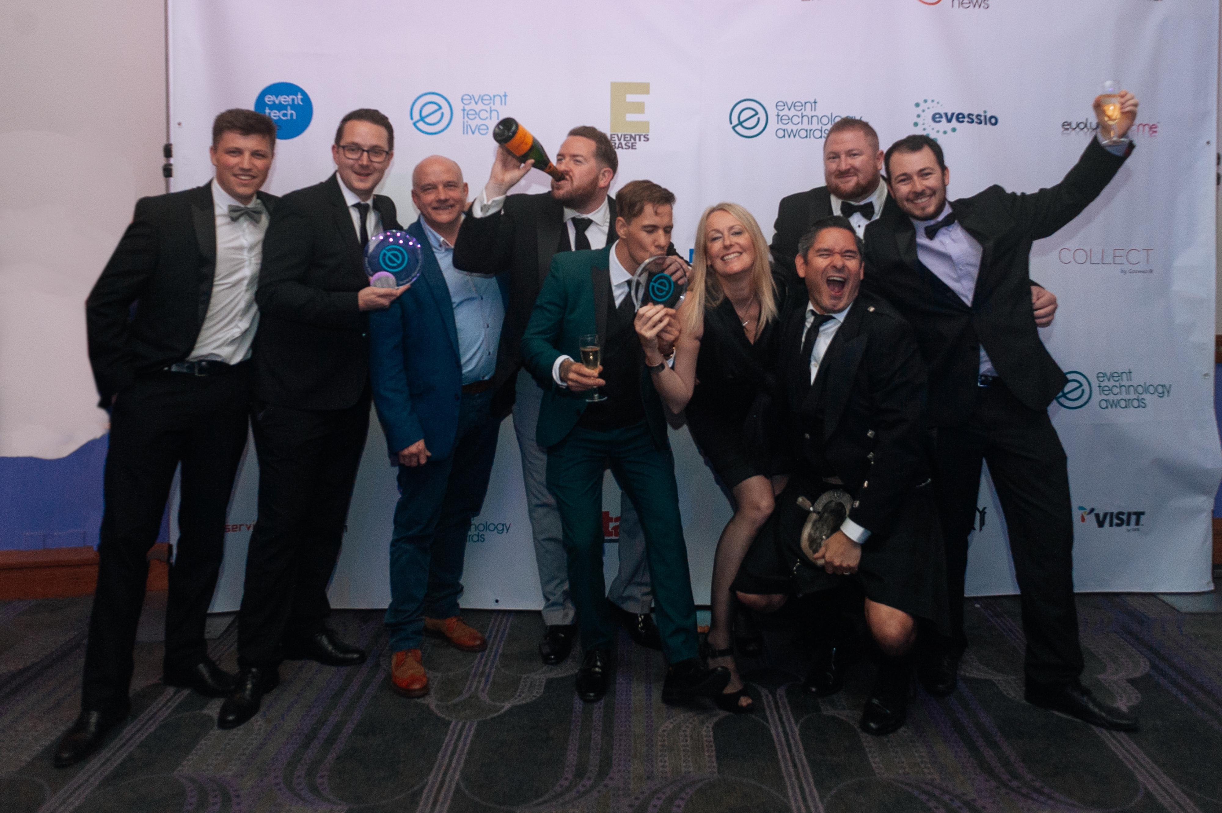 group celebrating event technology award win